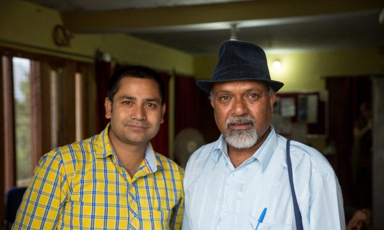Two Indian men posing
